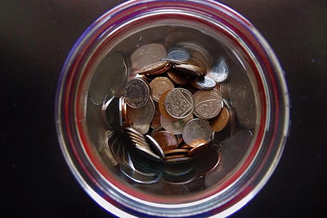 Coins placed inside a jar.